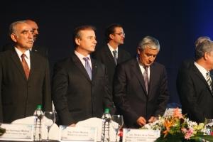 Guatemalan President Otto Perez Molina checks his cell phone