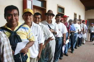 Guatemalan men smile while waiting payment