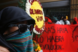 Guatemalan protestor wearing sunglasses